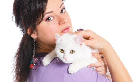 animal shelter: Young woman hold white cat
