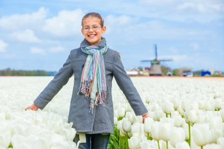 Girl in the purple tulips field Stock Photo - 13948957