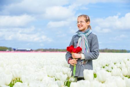 Girl in the purple tulips field Stock Photo - 13948952