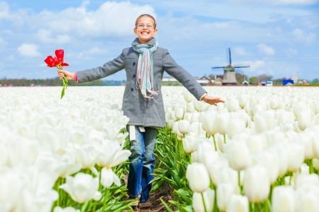 Girl in the purple tulips field Stock Photo - 13948915