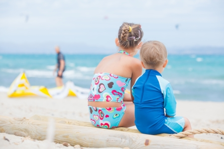 kiting: Boy and girl on beach vacation Stock Photo