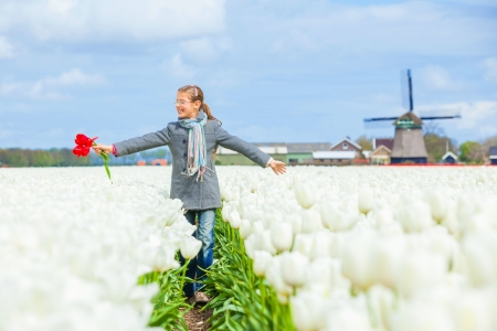 Girl in the purple tulips field Stock Photo - 13987490
