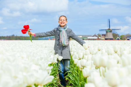 Girl in the purple tulips field photo