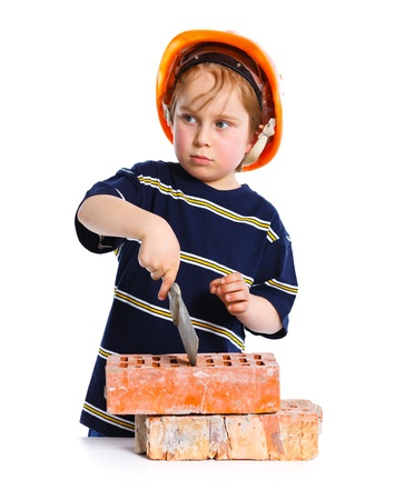 Boy in hard hat with brick Stock Photo - 13987455