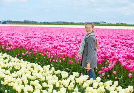 Girl in the colorful tulips field Stock Photo - 14023246