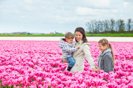 Mother with her child in tulips field Stock Photo - 14023244