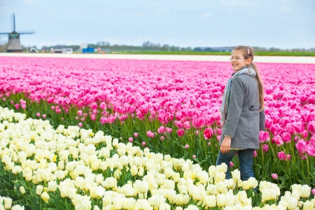 Girl in the colorful tulips field photo