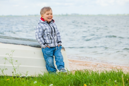 Boy Sitting on the boat photo
