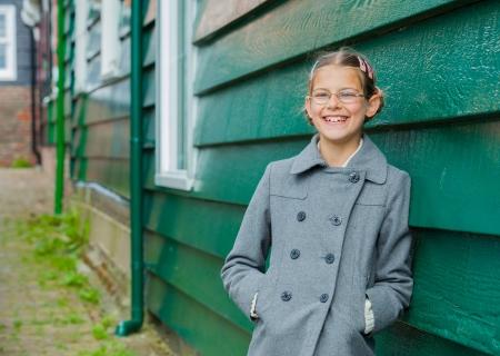 Girl near wall photo
