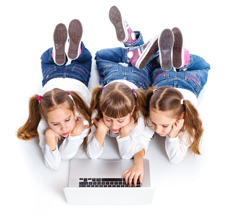 Three attractive girl using a laptop photo