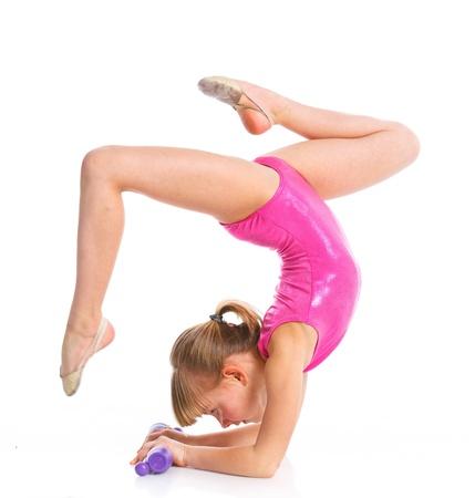 the acrobatics: Peque�a gimnasta Foto de archivo