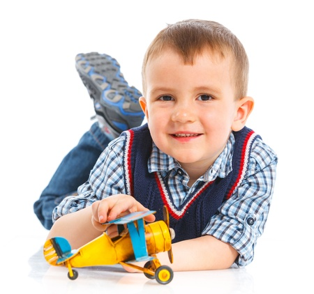 Cute little boy playing with a toy airplane photo