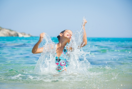 Young girl playing in the sea Stock Photo - 15290899
