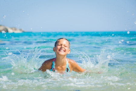 Young girl playing in the sea Stock Photo - 15290889