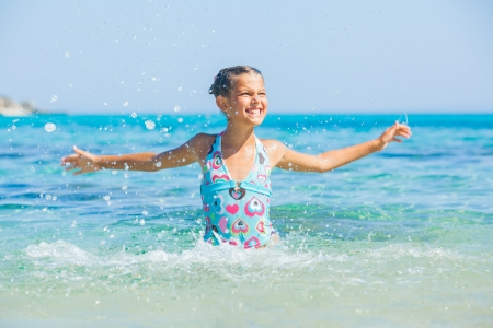 Young girl playing in the sea Stock Photo - 15407323