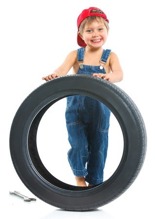 flat tyre: Little mechanic with a tire