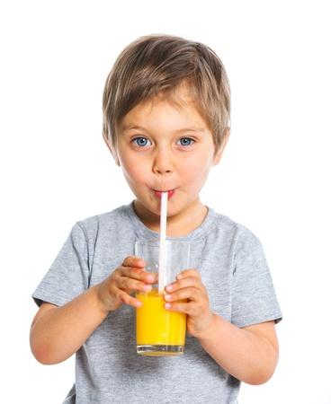 only one boy: Portrait of little boy drinking orange juice