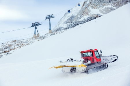 snowcat: Red machine for skiing slope preparations Stock Photo