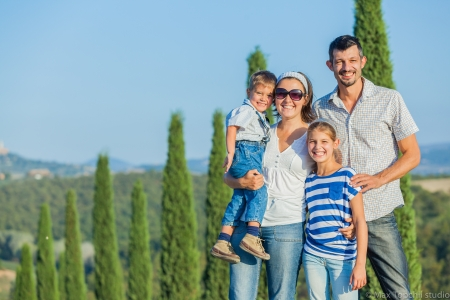Happy family having fun outdoors in Tuscan photo