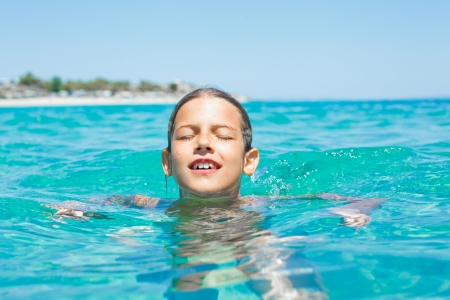 Young girl playing in the sea Stock Photo - 16242542