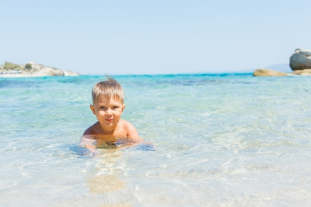 Cute boy playing in the sea Stock Photo - 16242540