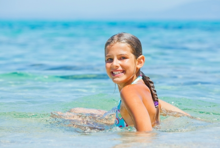 Young girl playing in the sea photo