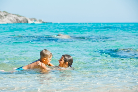 Kids playing in the sea Stock Photo - 16303438