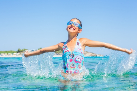 Young girl playing in the sea Stock Photo - 16334430