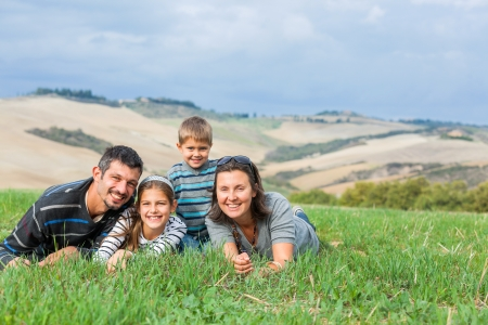 family and health: Happy family having fun outdoors in Tuscan