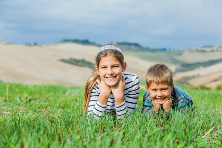 Happy kids having fun outdoors in Tuscan photo