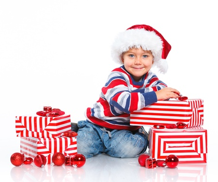 Little boy in Santa s hat with gift box Stock Photo - 16633471