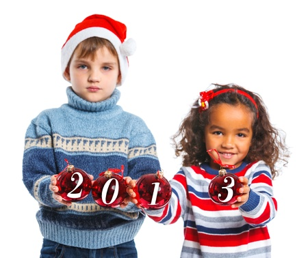 Kids in Santa s hat holding a christmas ball Stock Photo - 16660771