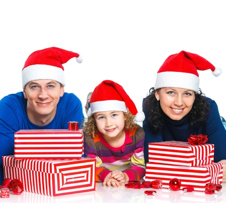 Family in Santa s hat with gift box photo