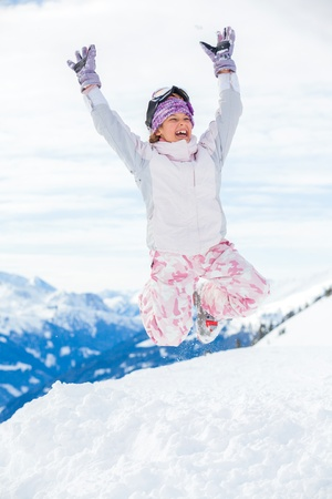 Young skier jumping photo