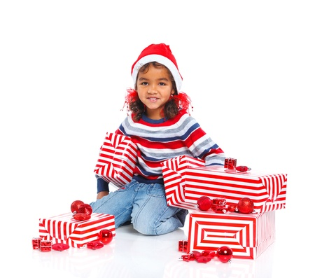 Little girl in Santa s hat with gift box photo