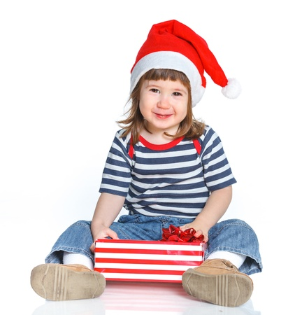Little girl in Santa s hat with gift box Stock Photo - 16859099