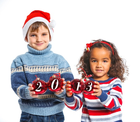 Kids in Santa s hat holding a christmas ball Stock Photo - 16792785