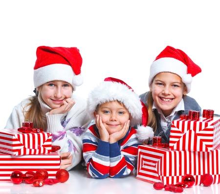 Happy kids in Santa s hat with gift box photo