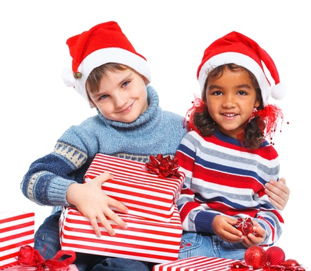 Little kids in Santa s hat with gift box photo