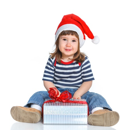 Little girl in Santa s hat with gift box Stock Photo - 16984965