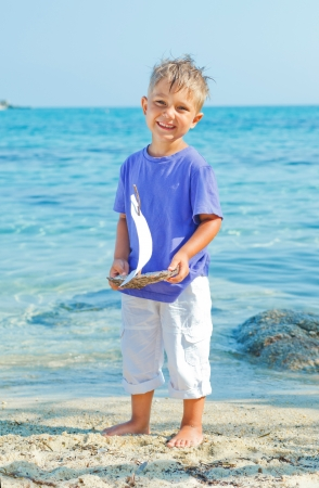 pool preteen: boy with toy ship Stock Photo