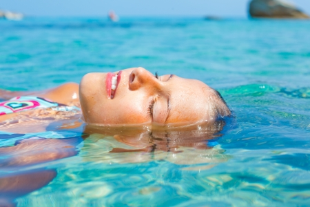 Young girl in the sea Stock Photo - 17159663