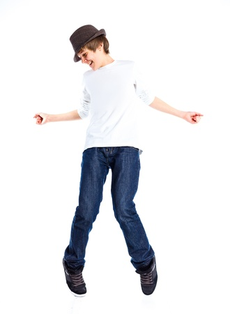 Boy dancing with a hat photo