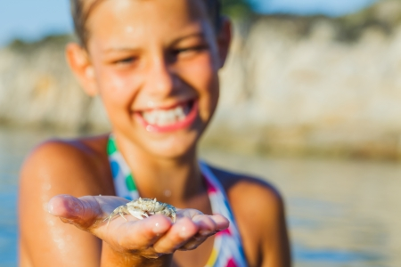 Girl holding crab  photo