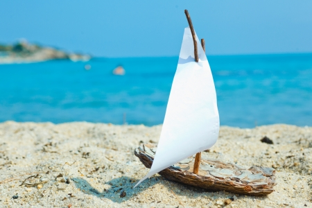 Ship toy model on the beach photo