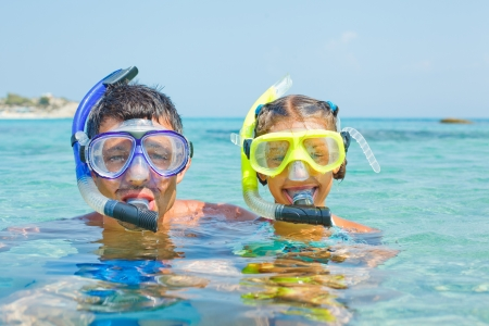 The girl with her father in scuba mask photo