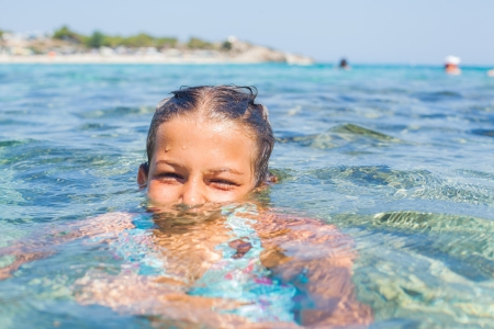 Young girl in the sea photo