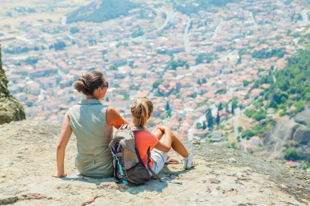bird s eye view: Mother and daughter looking at the town of Kalambaka bird s eye view  Meteora, Greece