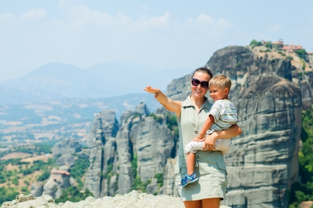 bird s eye: Mother and son looking at the town of Kalambaka bird s eye view  Meteora, Greece  Stock Photo