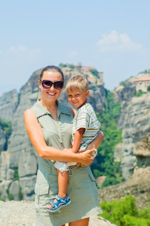 bird s eye: Mother and son looking at the town of Kalambaka bird s eye view  Vertical view  Meteora, Greece